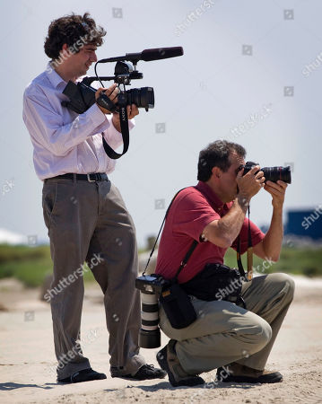 Arun Chaudhary, Pete Souza White House videographer Arun Chaudhary, left, and White House photographer Pete Souza photograph President Barack Obama in Port Fourchon, La., as he tour areas affected by the disastrous oil spill in the Gulf of Mexico
