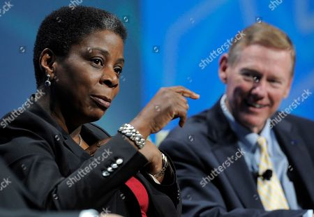 Ursula Burns, president and chief executive officer of Xerox, talks as Alan Mulally, president and chief executive officer of Ford, looks on during a Power Panel discussion at the 2012 International CES in Las Vegas. Xerox says Burns won't be CEO after the company splits in two later in 2016. Burns became CEO of Xerox in 2009, becoming the first black woman to lead a Fortune 500 company. Xerox says after the split she will become chairman of a newly formed document technology company