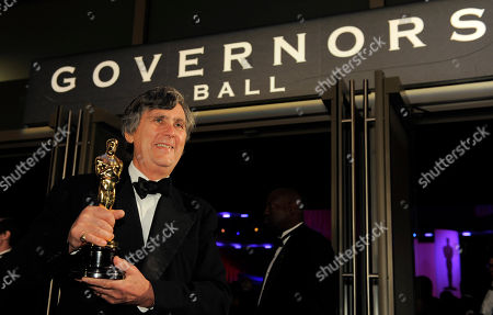 """John Midgley John Midgley with the Oscar for best sound mixing for """"Hugo"""" at the Governors Ball following the 84th Academy Awards, in the Hollywood section of Los Angeles"""