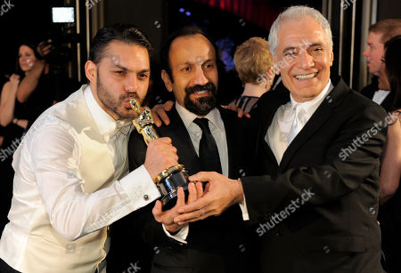 """Peyman Moadi, Asghar Farhadi, Mahmoud Kalari From left, Peyman Moadi, Asghar Farhadi with the Oscar for best foreign language film for """"A Separation"""" and Mahmoud Kalari at the Governors Ball following the 84th Academy Awards, in the Hollywood section of Los Angeles"""