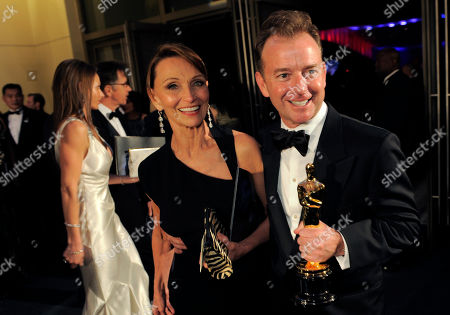 """Eugene Gearty Eugene Gearty, right, with the Oscar for achievement in sound editing for """"Hugo"""" at the Governors Ball following the 84th Academy Awards, in the Hollywood section of Los Angeles"""