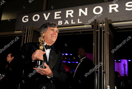 """John Midgley John Midgley with his trophy for best sound mixing for """"Hugo"""" at the Governors Ball following the 84th Academy Awards, in the Hollywood section of Los Angeles"""