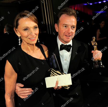 """Eugene Gearty Eugene Gearty, right, with the Oscar for achievement in a sound editing for """"Hugo"""" and guest at the Governors Ball following the 84th Academy Awards, in the Hollywood section of Los Angeles"""