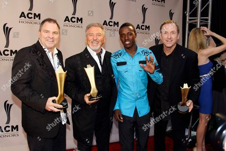 Larry Gatlin, Steve Gatlin, Rudy Gatlin, Romain Virgo The Gatlin Brothers are joined by Romain Virgo as they arrive at the Academy of Country Music Honors show, in Nashville, Tenn. From left are Steve Gatlin, Larry Gatlin, Romain Virgo, and Rudy Gatlin