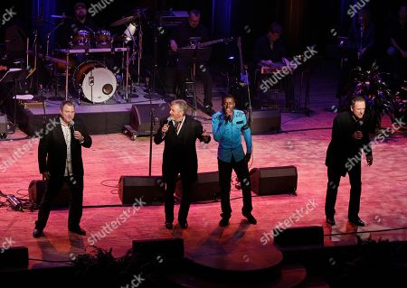 Steve Gatlin, Larry Gatlin, Rudy Gatlin, Romain Virgo The Gatlin Brothers perform with Romain Virgo during the the Academy of Country Music Honors show, in Nashville, Tenn. From left, are Steve Gatlin, Larry Gatlin, Romain Virgo, and Rudy Gatlin