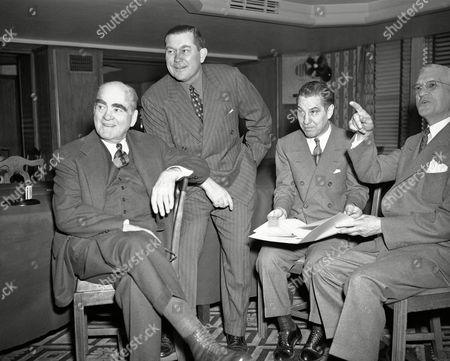 Attending the major-minor league baseball conference in New York, are, left to right: Ed Barrow, president of New York Yankees; Tom Yawkey, president of Boston Red Sox; Harry Grabiner, vice president of Chicago White Sox; and William Harridge, President of the American League