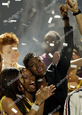 "BARRINO American Idol"" winner Fantasia Barrino, right, is congratulated by finalists Jasmine Trias, left, La Toya London, center, and John Stevens, back left, at the end of the show's live finale, in Los Angeles"