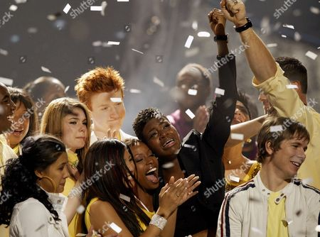 "BARRINO Fantasia Barrino, center with arm raised, reacts as she is surrounded by the other finalists after she was announced the winner of ""American Idol"" during the live finale, in Los Angeles. Embracing Barrino in the foreground are Jasmine Trias and La Toya London"