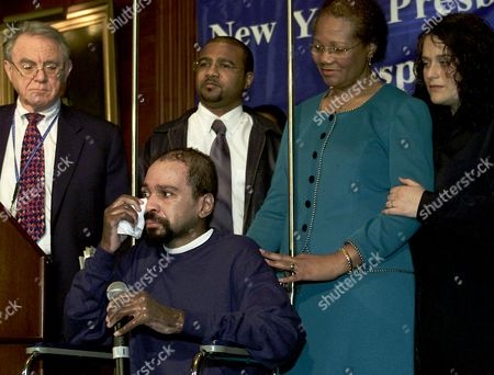 PARDES Donovan Cowan, center, wipes away tears as he prepares to leave the hospital, during a news conference in New York. Cowan, who sustained burns over 50 percent of his body in the World Trade Center attacks, walked down 84 floors to the lobby before receiving help. Surrounding Cowan is relative Jennifer Walker, right, his mother Jasmin Cowan, his brother Michael Cowan, and Dr. Herbert Pardes, left, president and CEO, New York-Presbyterian Hospital. He is transferring to a rehabilitation hospital