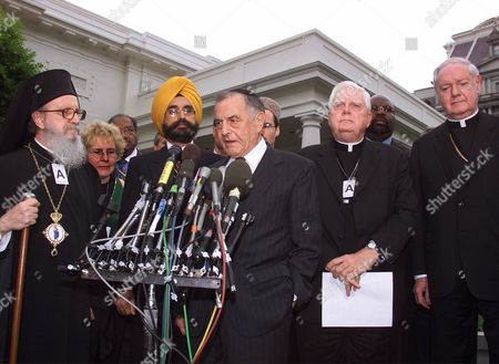 Stock Image of EGAN Religious leaders talk to reporters as they leave the White House, after meeting with President Bush. Left to right in the front row are, Archbishop Demetrios Trakatellis, from New York, Dr. Rajwant Singh, from Maryland, Rabbi Joahua Haberman, from the District of Columbia, Cardinal Bernard Law, from Boston, and Cardinal Edward Egan, from New York. Others are unidentified. Bush will speak to Congress and a national TV audience tonight on terrorism and his administration's plans to fight it