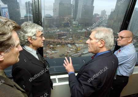 SCHWARTZ Architects Bill Morrish, left, Rafael Vinoly, second left, and Frederic Schwartz, right, of the Think group, listen to Alexander Garvin, vice president of planning, design and development of the Lower Manhattan Development Corp, as they look into the World Trade Center site from the LMDC offices