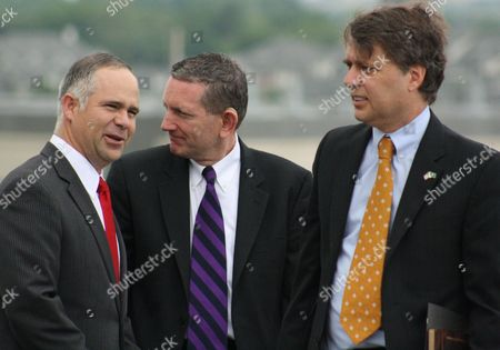 U.S. Rep. Tim Huelskamp, left; Jamie Johnson, center, director of national laboratories at the U.S. Department of Homeland Security, and Lt. Gov. Jeff Colyer chat before breaking ground, on a utility plant for the new federal biosecurity lab in Manhattan, Kan. The $1.2 billion lab will replace an aging facility at Plum Island, N.Y., and conduct research on animal diseases