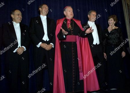 EGAN From left, New York City Mayor Rudolph Giuliani, New York Gov. George Pataki, New York Archbishop Edward Egan, Republican presidential candidate Texas Gov. George W. Bush and his wife, Laura Bush, pose for photographers before attending the 2000 Alfred E. Smith Memorial Foundation Dinner, in New York