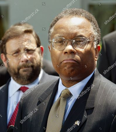 PITT THOMPSON Deputy Attorney General Larry Thompson, joined at left by Securities and Exchange Commission Chairman Harvey Pitt, speaks with reporters outside the White House West Wing, following the first meeting with President Bush of the corporate fraud task force, . Bush is seeking to reassure shaken investors and contain political fallout amid a string of business scandals