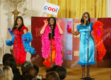 "Stock Photo of The Vowelles, "" a PBS children's television singing group from the show ""Between the Lions,"" from left to right, Nicki Richards, Paulette McWilliams, and Cindy Mizelle perform for first lady Laura Bush and others during a early childhood education event in the East Room of the White House, . Yesterday President Bush unveiled a new early childhood proposal to help states and local communities strengthen early learning for children"
