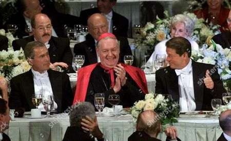 BUSH GORE EGAN Democratic presidential candidate Vice President Al Gore, right, reacts as New York Archbishop Edward Egan, center, and Republican presidential candidate Texas Gov. George W. Bush look on during the 2000 Alfred E. Smith Memorial Foundation Dinner, in New York