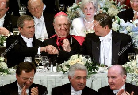 BUSH GORE EGAN Republican presidential candidate Texas Gov. George W. Bush, left, shakes hands with Democratic presidential candidate Vice President Al Gore, right, as New York Archbishop Edward Egan looks on at the start of the Alfred E. Smith Memorial Foundation Dinner, in New York
