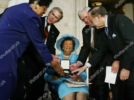 HASTERT President Bush, second left, presents the Congressional Gold Medal to civil rights advocate Dorothy Height, center, with House Speaker Dennis Hastert, R-Ill., second right, Sen. Ted Stevens, R-Alaska, right, and Rep. Diane Watson, D-Calif., left, at the Capitol Rotunda in Washington