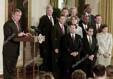 PARKER President Bush introduces his federal judicial appointments, in the East Room of the White House. First row, left to right, Judge Dennis Shedd, Miguel Estrada, Judge Priscilla Owens, second row, Jeffrey Sutton, Judge Edith Brown Clement, Judge Roger Gregory, John Roberts, third row, Judge Terrence Boyle, Michael McConnell, Judge Deborah Cook, and Judge Barrington Parker