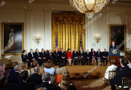Stock Image of QUINTAL President Bush delivers his remarks before presenting the Presidential Medal of Freedom, the nation's highest civil award, during a ceremony in the East Room of the White House, . Seated from left are, Mrs. Edith Bartley on behalf of Robert L. Bartley, Edward W. Brooke, Vartan Gregorian, Gilbert M. Grosvenor, Gordon B. Hinckley, Leonard and Ronald Lauder on behalf of their mother Este Lauder, Rita Moreno, Arnold Palmer, Arnall Patz Norman Podhoretz, Catherine and Richard Quintalon behalf of their father Walter B. Wriston and Rev. Gabriel Montalvo on behalf of Pope John Paul II