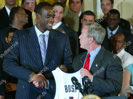 BUSH OKAFOR President Bush, right, shakes hands with Connecticut's Emeka Okafor, as Bush met with NCAA champions of several sports in the East Room event at the White House in Washington, in Washington