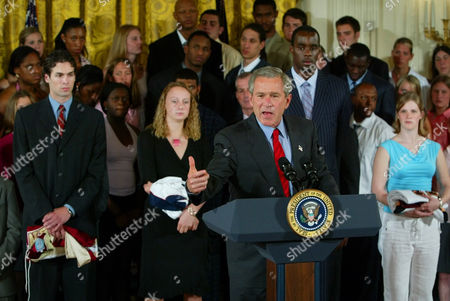 BILLS President Bush, center, gestures as he met with NCAA champions of several sports in the East Room event at the White House in Washington, in Washington. Standing behind Bush are from left to right, Denver's Ryan Caldwell, Connecticut's Maria Conlon, Connecticut's Emeka Okafor, and Minnesota women's team hockey captain Kelsey Bills