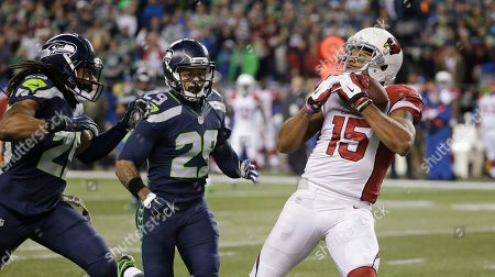 Michael Floyd Arizona Cardinals wide receiver Michael Floyd (15) makes a catch as Seattle Seahawks free safety Earl Thomas, center, and cornerback Richard Sherman defend during the first half of an NFL football game, in Seattle