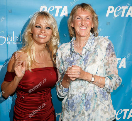 Pamela Anderson; Ingrid Newkirk Pamela Anderson and PETA President Ingrid Newkirk, right, pose for photographers as they arrive for Anderson's 40th birthday party at the Sublime cafe, a popular vegan hotspot, in Fort Lauderdale, Fla