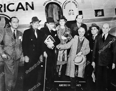 Watchf Associated Press Domestic News California United States APHS60223 CHARLIE CHAPLIN WITH HOLLYWOOD ELITE Charlie Chaplin,center, holding his hat, joins friends and film figures in front the Douglas Sleeper transport, famous piston-engined airplane of the thirties, operated over American Airlines' transcontinental routes. Hollywood celebrities were constant commuters on the sleeper verions of the DC-3, a piston-engined aircraft. The cross-country flights took nearly 20 hours and three stops compared to just five hours in a modern carrier. This is an undated photo. Included in this group of famous early film figures are Mary Pickford, center, Douglas Fairbanks, second from left wearing white tie; Sam Goldwyn, at right, Sir Alexander Korda, Dr. A.H. Giannini, and Murray Siverstone, the president of United Artists