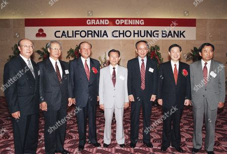 From left to right are Byung Jun Lee, president of Pusan Pipe, Jong Il Kim, president of California Center Bank, Chong Yeon Lee, honorary president of Cho Hung Bank, Jang Woo Lee, president of Radio Korea, Professor Sung Ki Kim, Chan Moke Woo, chairman and president of Cho Hung Bank and Soo Bong Min, president of Hanmi bank, seen together, at the grand opening reception of California Cho Hung Bank in Los Angeles