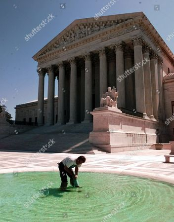 KELLY Dennis Kelly, who works for the Architect of the Capitol, adjusts the baffle of a fountain outside the Supreme Court in Washington, . Under deadline pressure, President Clinton was meeting with his lawyers Monday to discuss whether to switch legal strategy and drop his court appeal of executive privilege in the Monica Lewinsky case. White House officials said consideration was being given to notifying the Supreme Court that the president would not appeal on executive privilege grounds
