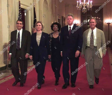 DOVE President Clinton and first lady Hillary Rodham Clinton walk down the State Floor hallway with Poets Laureate Robert Pinsky, left, Rita Dove, center, and Robert Haas, right, before the Millennium Evening Lecture at the White House in Washington