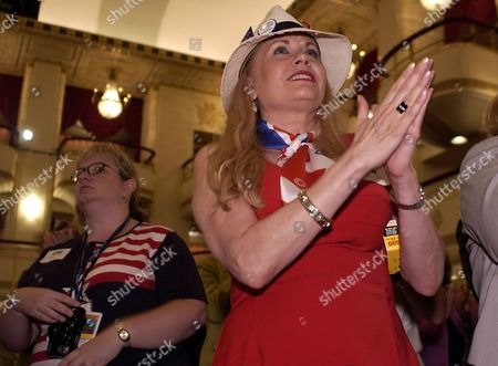 Stephanie Sue Parker, from New York, N.Y., applauds during a speech by Barbara Bush, the president's mother, at the W Stands for Women rally in the Waldorf Astoria Hotel in New York on