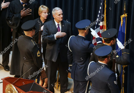 Lorie Skjerven Gildea, Mark Dayton Minnesota Chief Justice Lorie Skjerven Gildea, left, and Minnesota Gov. Mark Dayton hold their hand over their hears during the presentation of colors during Datyon's inauguration ceremony, in St. Paul, Minn. Dayton is beginning his second term in office