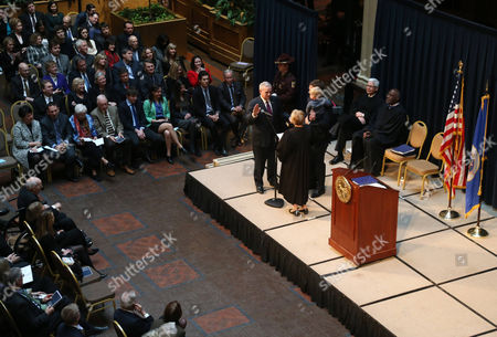 Stock Picture of Lorie Skjerven Gildea, Mark Dayton Minnesota Chief Justice Lorie Skjerven Gildea administers the oath of office to Minnesota Gov. Mark Dayton (with hand raised) during his inauguration ceremony, in St. Paul, Minn. Dayton is beginning his second term in office