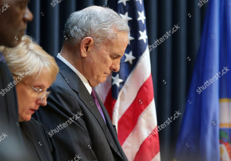 Lorie Skjerven Gildea, Mark Dayton Minnesota Gov. Mark Dayton bows his head during the invocation along with Minnesota Chief Justice Lorie Skjerven Gildea, center, and Justice Alan Page during his inauguration ceremony, in St. Paul, Minn. Dayton is beginning his second term in office