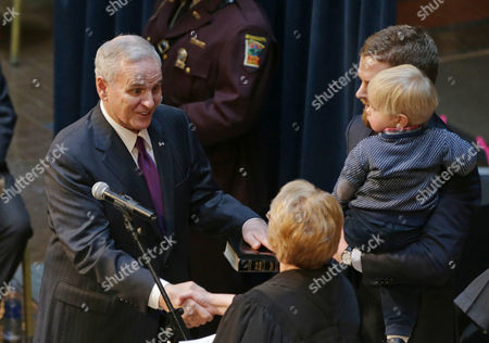 Lorie Skjerven Gildea, Mark Dayton Minnesota Chief Justice Lorie Skjerven Gildea congratulates Minnesota Gov. Mark Dayton, left, during his inauguration ceremony, in St. Paul, Minn. Dayton is beginning his second term in office. Looking, right, is one of Dayton's sons and grandson, Hugo