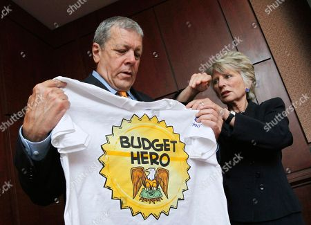 """John Tanner, Jane Harman Former Tennessee Rep. John Tanner, left, accompanied by former California Rep. Jane Harman, President, CEO, and Director of the Woodrow Wilson International Center for Scholars, shows his Budget Hero shirt at the Wilson Center's re-launching of the """"Budget Game"""" on Capitol Hill in Washington"""