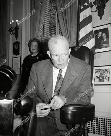 President Dwight Eisenhower listens closely to a recording of his own voice as broadcast from America's new 4½-ton satellite orbiting in outer space, . The broadcast of Eisenhower's message was picked up at Cape Canaveral. It was recorded there, relayed to the Pentagon, then to the White House. Associate White House Press Secretary Anne Wheaton stands in background