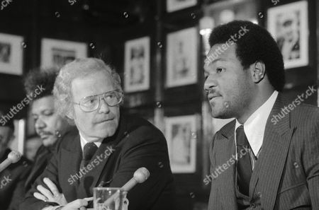 George Foreman, Roone Arledge Former World Heavyweight boxing champion George Foreman chats with Roone Arledge, President of ABC-TV Sports, on occasion Foreman signed 3-year contract with the broadcast organization