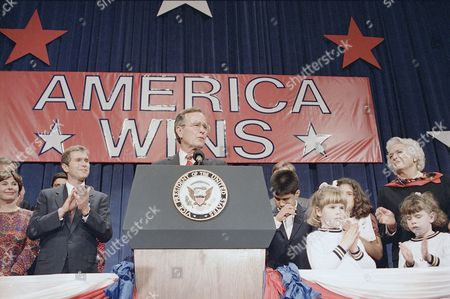President-elect George H. W. Bush, center, shown during his victory rally, Houston, Texas. Other Bush family members from left: Laura Bush, George W. Bush; George H. W. Bush; George P. Bush, twins; Jenna and Barbara Bush, and the Pres. elects wife Barbara Bush