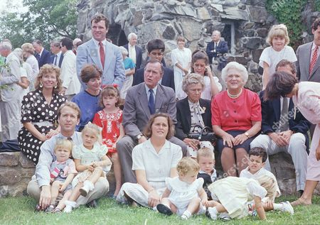 Vice President George H. W. Bush, center, poses with his family outside St. Anns Church, Kennebunkport, Me. The Bush family from left front row: Neil Bush, Pierce Bush, Lauren Bush, Dorothy Bush, and Ellie LeBlond. The rest of the children in the front row are unidentified. Second row from left: an unidentified woman, Laura Bush, Jenna Bush, George H. W. Bush, Dorothy Bush and Barbara Bush. Back row from left are: Jeb Bush, George P. Bush and Noelle Bush. The rest of the group is unidentified