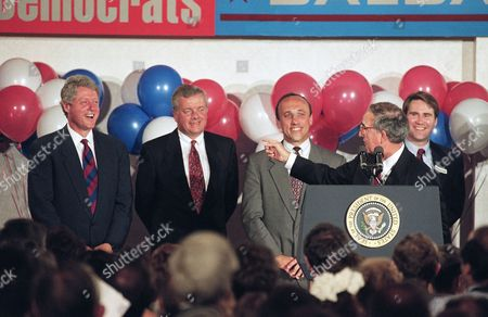 Stock Picture of George Mitchel, Bill Clinton, Joe Brennan,Tom Andrews, David Wilhelm Senator Majority Leader George Mitchell points to President Bill Clinton while speaking at a fund-raising event for State Democrats in Portland, Maine . Clinton, standing alongside former governor Joe Brennan, Rep. Tom Andrews, and Democratic National Chairman David Wilhelm, made a brief trip to Maine to attend two fund-raisers before leaving for Boston