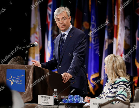 Stock Picture of Hubert Joly, Mary Fallin Hubert Joly, left, president and CEO of Best Buy, addresses the closing session of the National Governors Association convention, in Nashville, Tenn. At right is Oklahoma Gov. Mary Fallin
