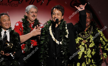 Wayne Wong, Paul Konwiser,George Kahumoku,Daniel Ho Producers Daniel Ho, center, accepts best Hawaiian music album at the Grammy Awards, in Los Angeles. In background looking on are, Wayne Wong, Paul Konwiser and George Kahumoku