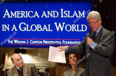 """CLINTON AMIRYAR DERGHAM Panelists Quadir Amiryar, left, a Professor of Public International Law at George Washington University, and Raghida Dergham, center, a senior diplomatic correspondent for London-based Al Hayat, an independent Arabic daily newspaper, listen as former President Clinton speaks at a forum on """" Islam and America in a Global World,"""", at New York University Law School in New York. The forum is sponsored by the William Jefferson Clinton Presidential Foundation"""