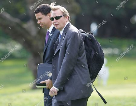 Jim Messina, Bill Burton Deputy Chief of Staff Jim Messina walks with Deputy Press Secretary Bill Burton on the South Lawn of the White House in Washington, as they accompany President Barack Obama to Providence, R.I
