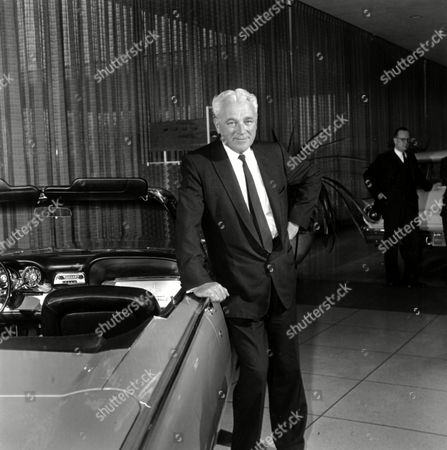 Stock Picture of JOHN DYKSTRA President of the Ford Motor Company John Dykstra poses by a 1961 model Ford in Detroit, Mich, on