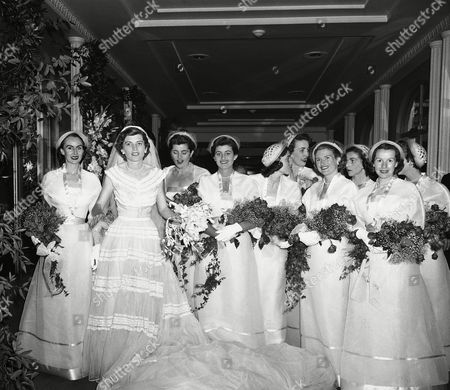Eunice Kennedy Shriver, second from left, daughter of the former U.S. Amb. Joseph P. Kennedy, stands with her attendants before reception, at Waldorf Astoria Hotel in New York. Reception followed her marriage to Robert Sargent Shriver, Jr., of Chicago in a ceremony at St. Patrick's Cathedral