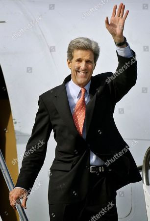 KERRY Democratic presidential candidate Sen. John Kerry, D-Mass.,waves as he walks down the steps from his plane as he arrives at Los Angeles International Airport . Kerry was in Los Angeles to attend a gala at the home of billionaire supermarket mogul Ron Burkle. Actors Ben Affleck, Leonardo DiCaprio and Barbra Streisand were expected to attend, with singer James Taylor performing